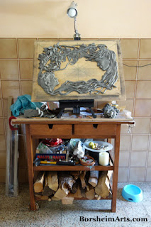 Kitchen as art studio bas-relief sculpture compressed form