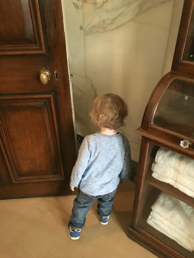 toddler-looking-behind-door