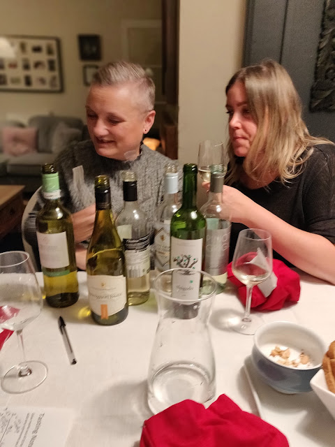 madmumof7 and friend tasting budget priced wine from Aldi and Lidl