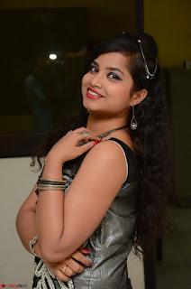 Shrisha Dasari in Sleeveless Short Black Dress At Follow Follow U Audio Launch 067.JPG