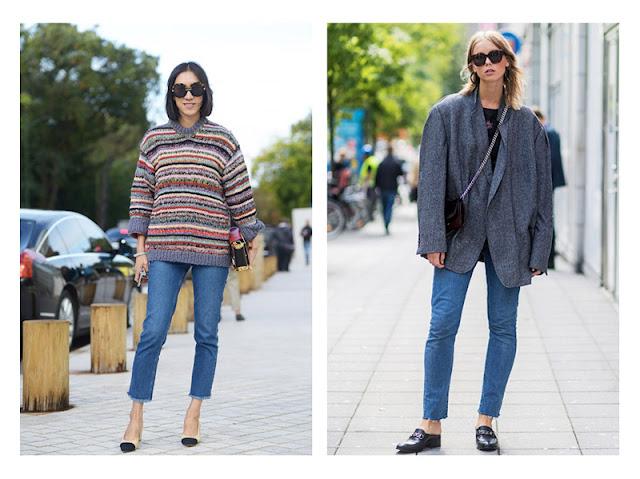 Девушки в узких джинсах и свободном свитере и жакете