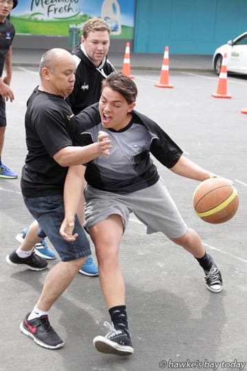 L-R: Leo Vivero, UnisonFibre; Cruz Davies, playing for the police - 4 on 4 street basketball, part of Nui Street Ball, an event for six Maraenui primary schools organised by Maraenui Police in the Maraenui Shopping Centre, Maraenui, Napier. photograph