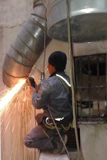 foto quitar tubos viejos chimenea