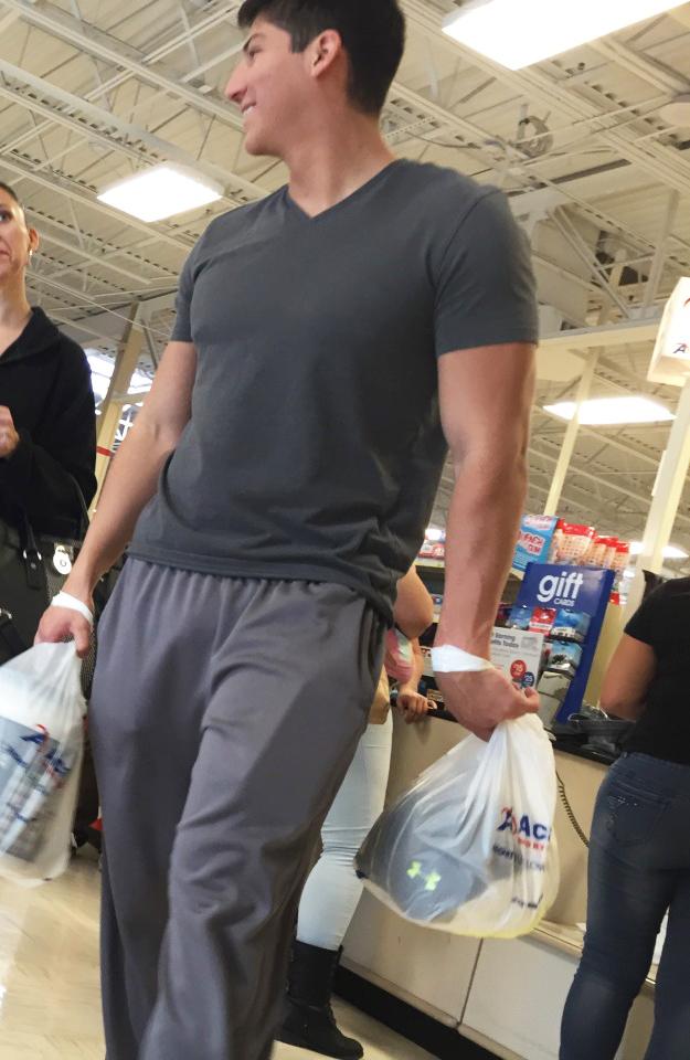 Cock bulges in sweatpants