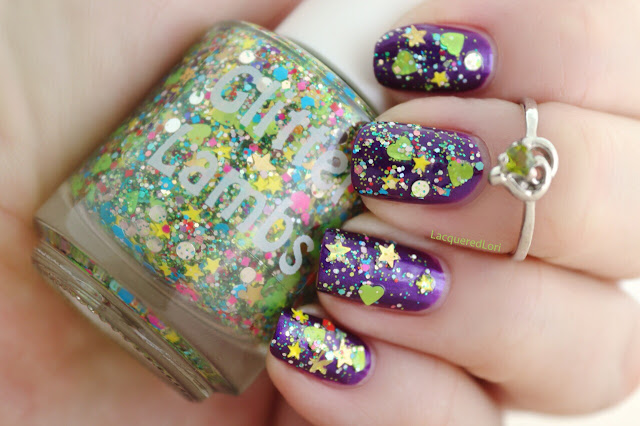Christmas custom handmade indie lacquer for the holiday season. Purple nails with glitter shapes on nail neon green hearts, yellow stars and more.