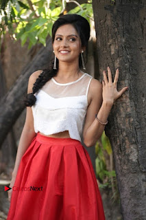 Actress Mahima Nambiar Latest Stills in White Top and Red Skirt at Kuttram 23 Movie Press Meet  0009.jpg