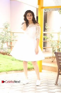 Actress Tejaswini Pictures in White Dress at Lachhi Teaser Launch 0221