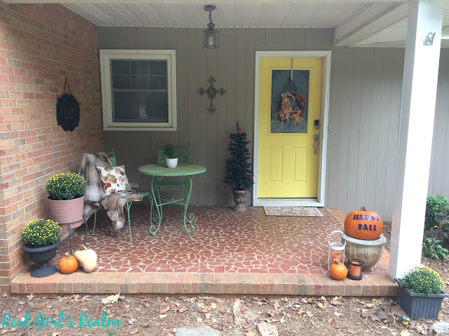 Decorate your front porch for fall with pumpkins and mums