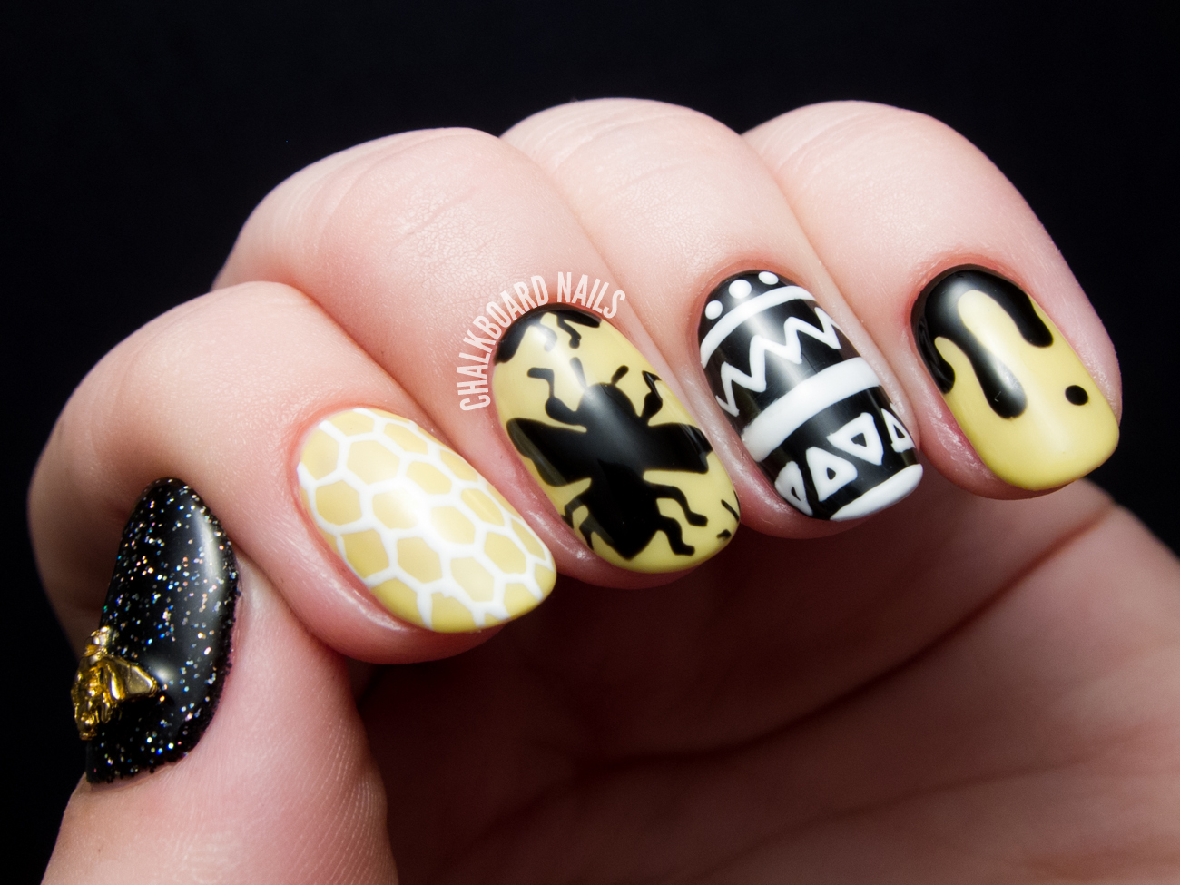 Freehand bee nail art by @chalkboardnails