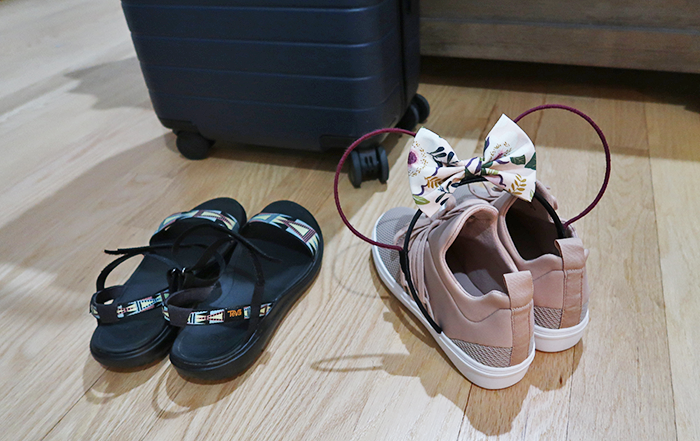 a style caddy, travel, travel tips, Disney world, Disneyland, pack with me, Disney pack with me, Steve Madden sneakers, tea sandals, the mad hattear, Mickey Mouse ears, away travel, away suitcase
