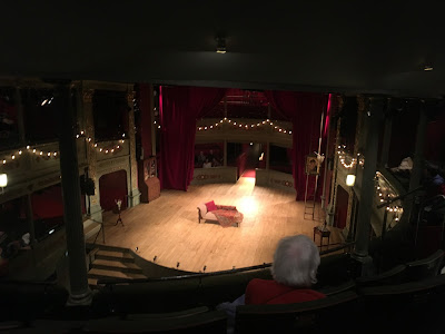 photo of the (empty) stage from the circle, showing 'fiary lights' around the stage, and the temporary seating behind the stage