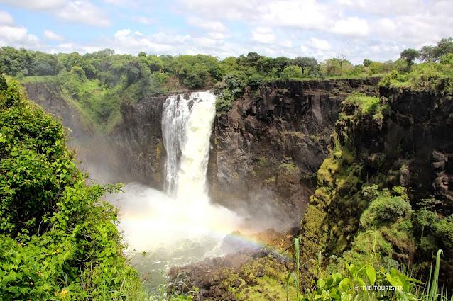 A rainbow over a waterfall.