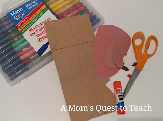 Materials of markers, construction paper, glue stick for craft