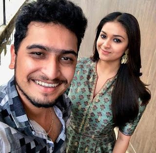 Keerthy Suresh with Cute and Lovely Smile with a Fan