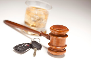 Judge's gavel, car keys and a drink