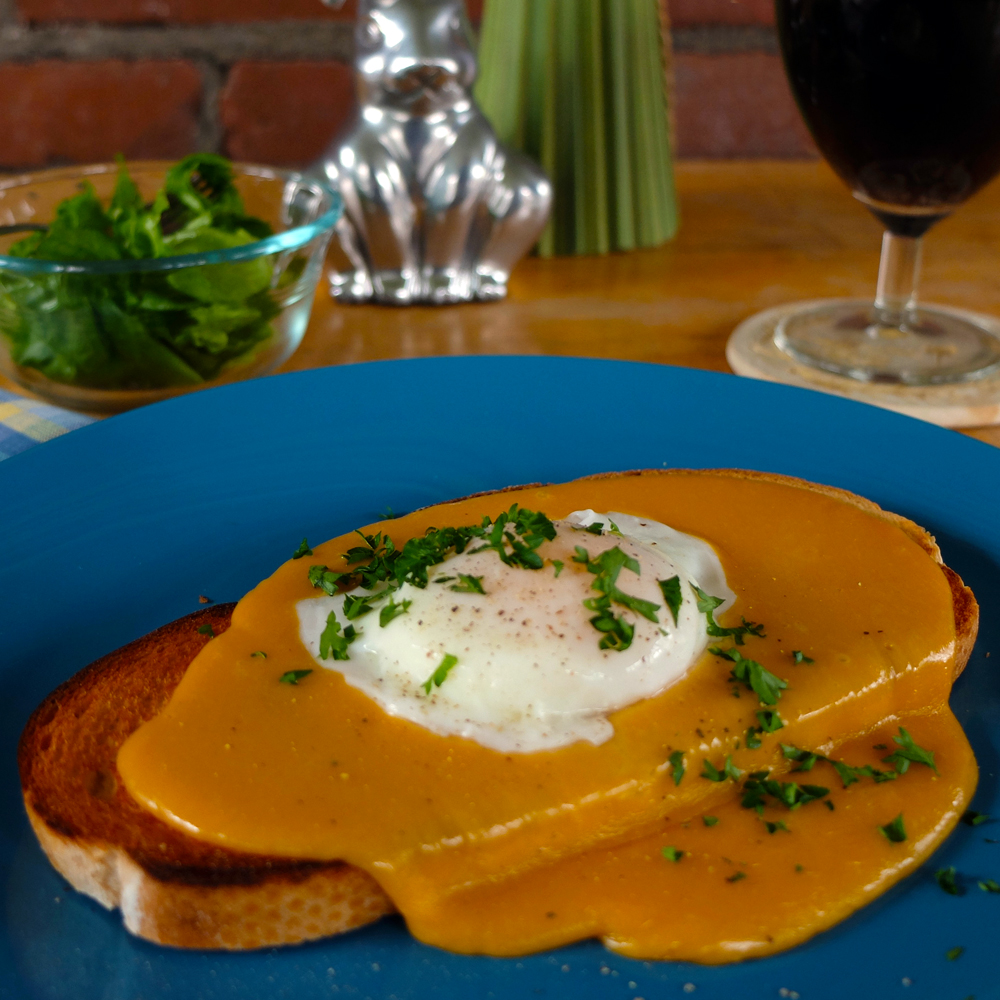 Make the Golden Buck, a delicious variation of Welsh rabbit (cheese sauce over toast).