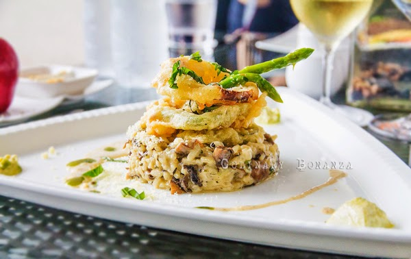 Risotto Arborio mixed with organic mushroom, vegetable tempura, asparagus, pesto custard and mascarpone cream