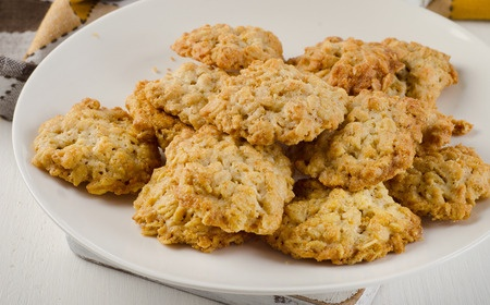 Homemade ANZAC Biscuits tasty easy to make and cheap from the Cheapskates Club Biscuits Recipe File