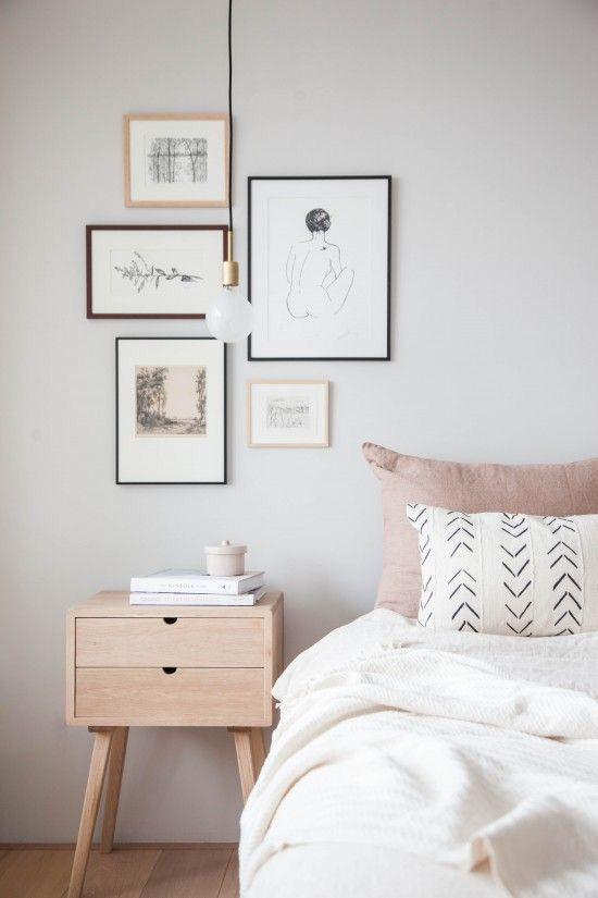 minimalist blush bedroom decor with Scandinavian art