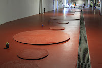 Construction and coating of pads to support chemical tanks.