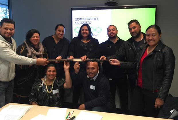 Growing Pasifika Niu Leaders participants holding the Matua Tokotoko