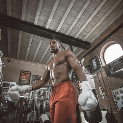 Anthony Joshua shows off his huge fighter body ahead of Saturday fight