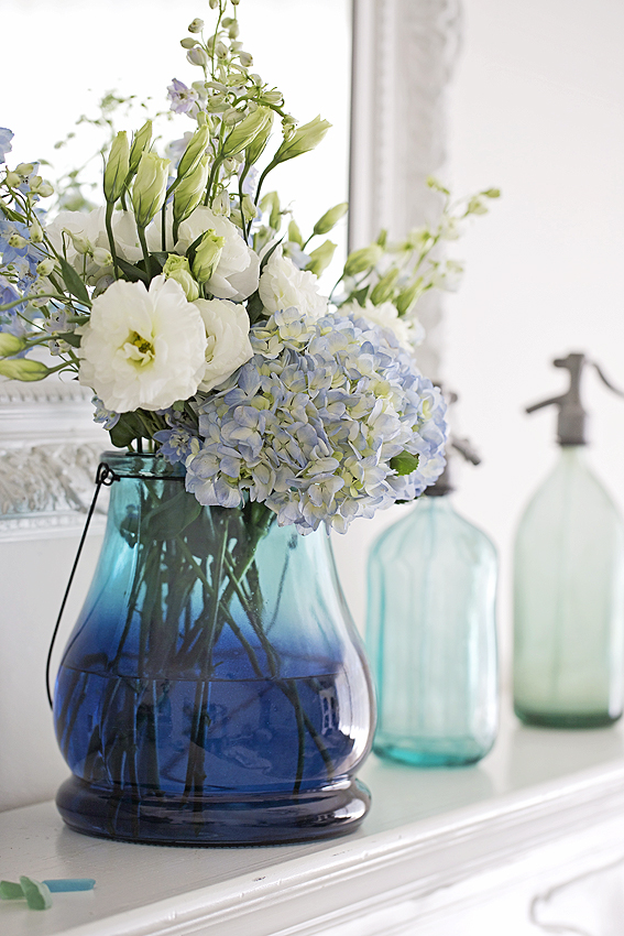 blue lantern filled with flowers