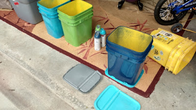 Upcycled Kitty Litter Buckets being Spray Painted.