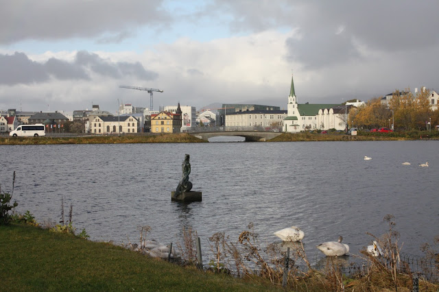 Lovely Tjornin Pond in central Reykjavik, Iceland is full of waterfowl and surrounded by sculptures creating a gathering place for locals and visitors alike.