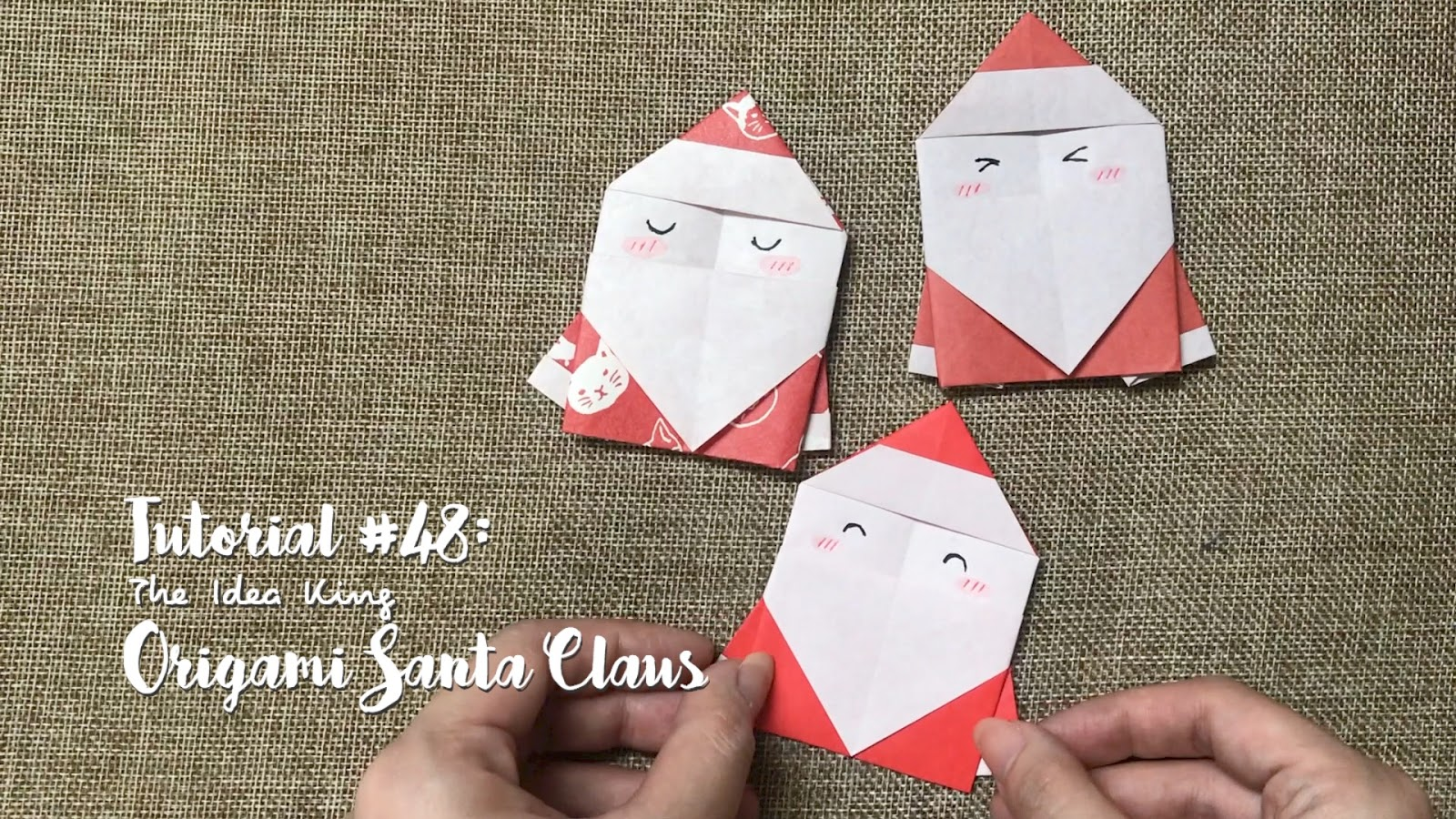 rows of origami Santa Claus Father Christmas decorations set on ... | 900x1600