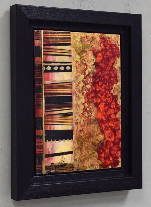 red, gold and black dimensional framed painting