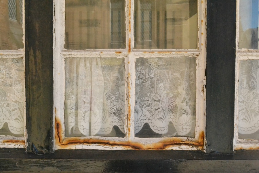 eroded window frame net curtains old wood montrose scotland angus coastal route seaside