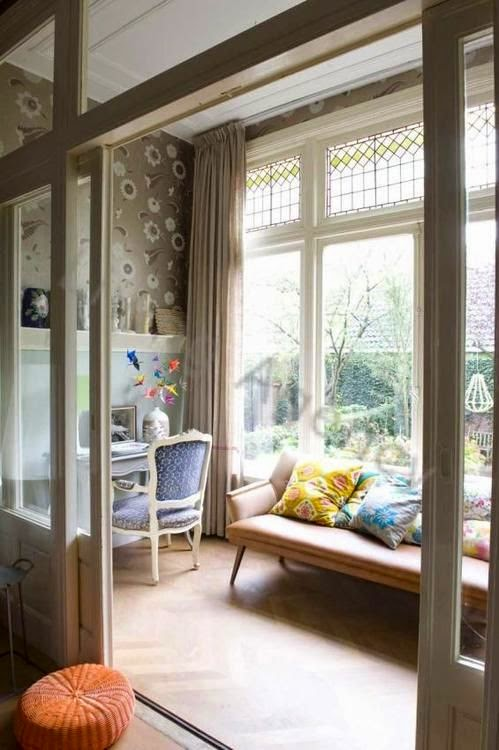 Michelle: The sunroom is transformed into office