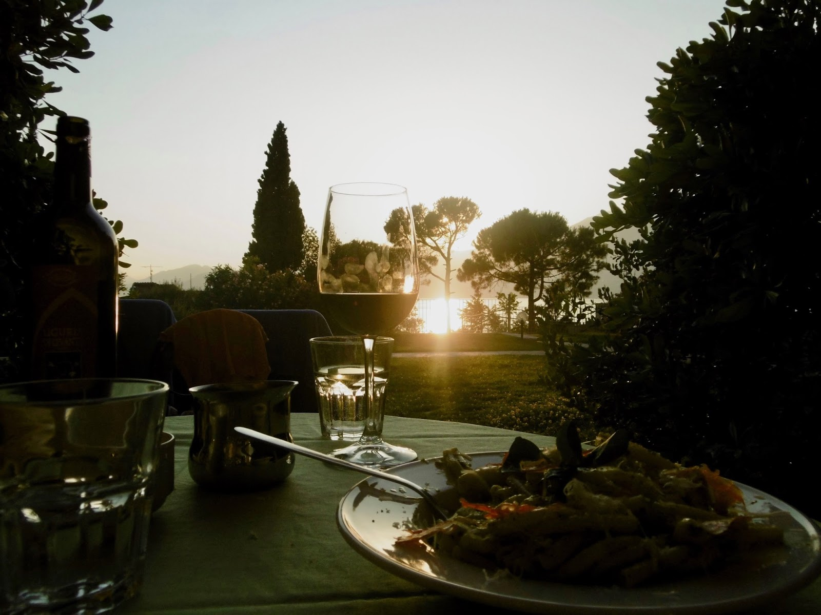 Cal McTravels having dinner at sunset at Lake Garda, best places to visit in Italy