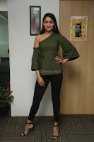 Pragya Jaiswal in a single Sleeves Off Shoulder Green Top Black Leggings promoting JJN Movie at Radio City 10.08.2017 046.JPG