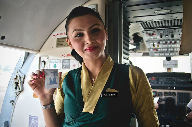 Flight attendant showing her ID card