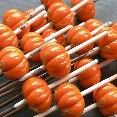 Handmade lampwork glass pumpkin beads by Laura Sparling