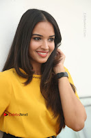 Actress Poojitha Stills in Yellow Short Dress at Darshakudu Movie Teaser Launch .COM 0169.JPG