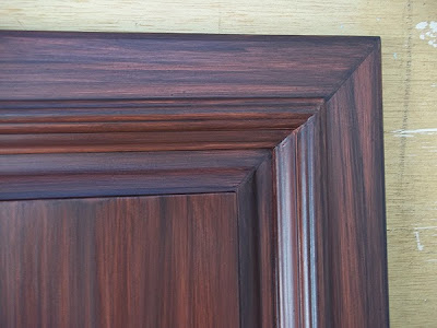 wood grain pained on kitchen cabinet
