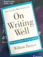 On Writing Well, by William Zinsser, superimposed on Intermediate Physics for Medicine and Biology.
