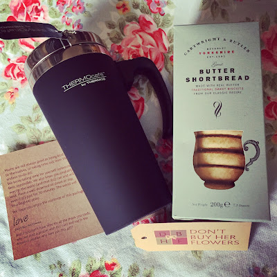 thermos flask and biscuits - staple gift for new parent