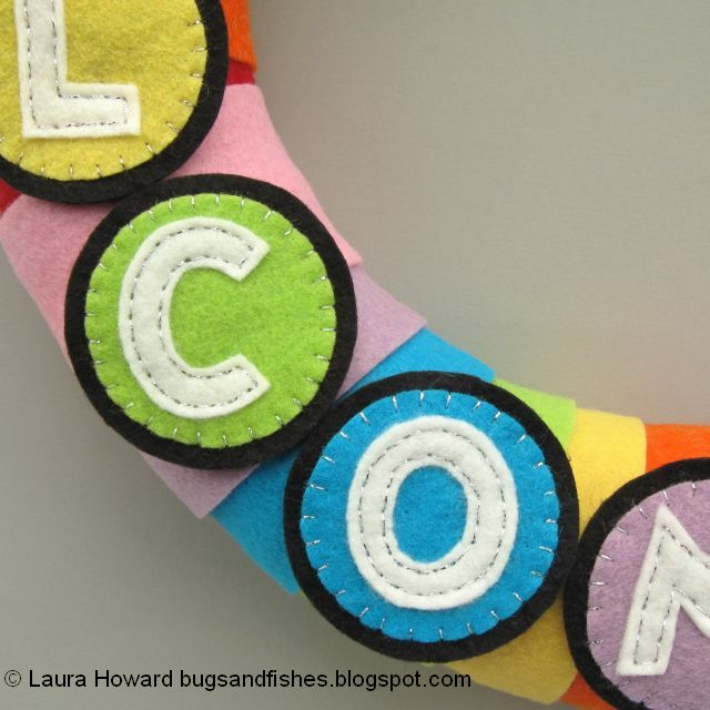 felt letters in place on the rainbow wreath