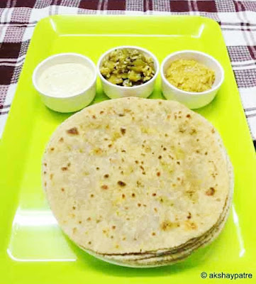 broccoli stuffed paratha in a serving plate