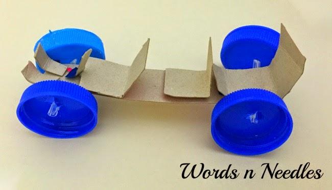 diy racer car cardboard box and bottle caps