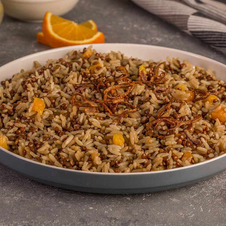 Cracked rice with dried apricots and oranges