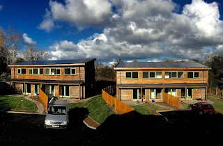 Brand new passive solar homes for affordable social housing, covered in solar panels.