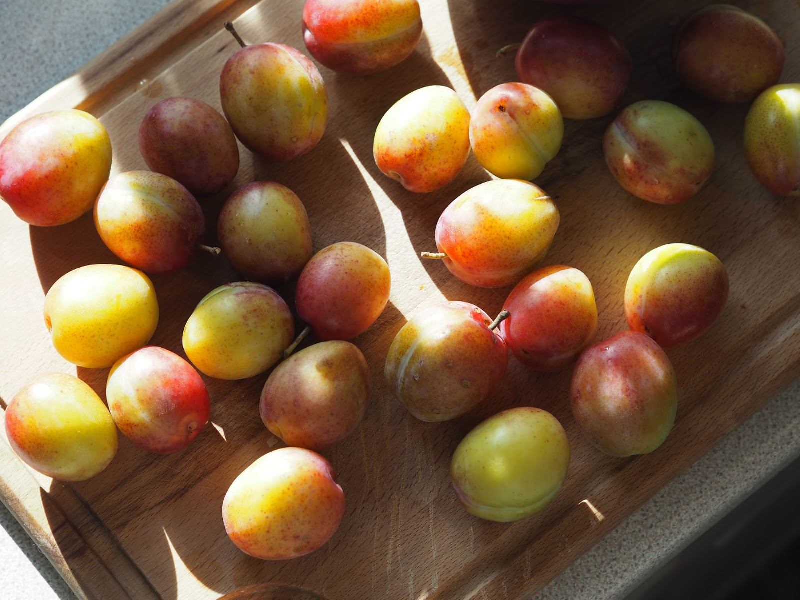 Plums on the chopping board