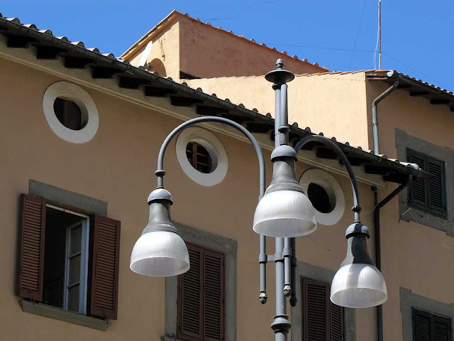 Round windows, street light, Town Hall, Livorno