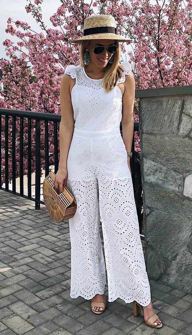 what to wear with a hat : bag + nude heels + white jumpsuit