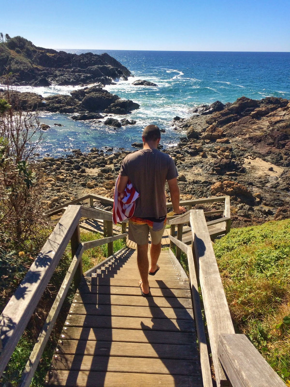 Boy walking to Little Bay Port Macquarie